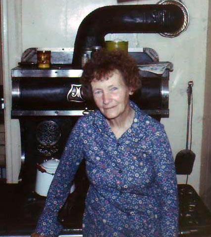 Josephine Jewett with wood cook stove.