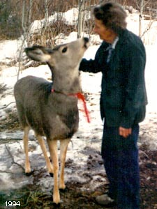 Josephine Jewett petting a deer.
