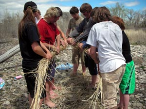 Grass rope making group effort.