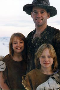 Thomas J. Elpel with daughters, all in buckskin clothing.