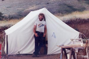 Thomas J. Elpel with wall tent while building a house.