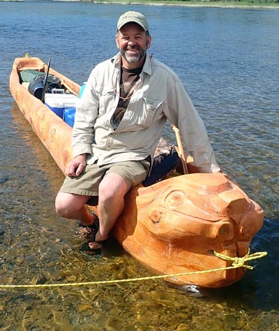 Tom Elpel with Belladonna Beaver the dugout canoe.